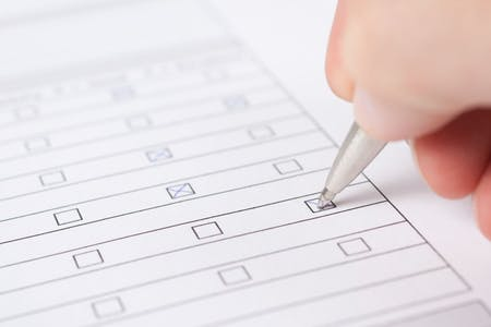 Checking form box with a pencil
