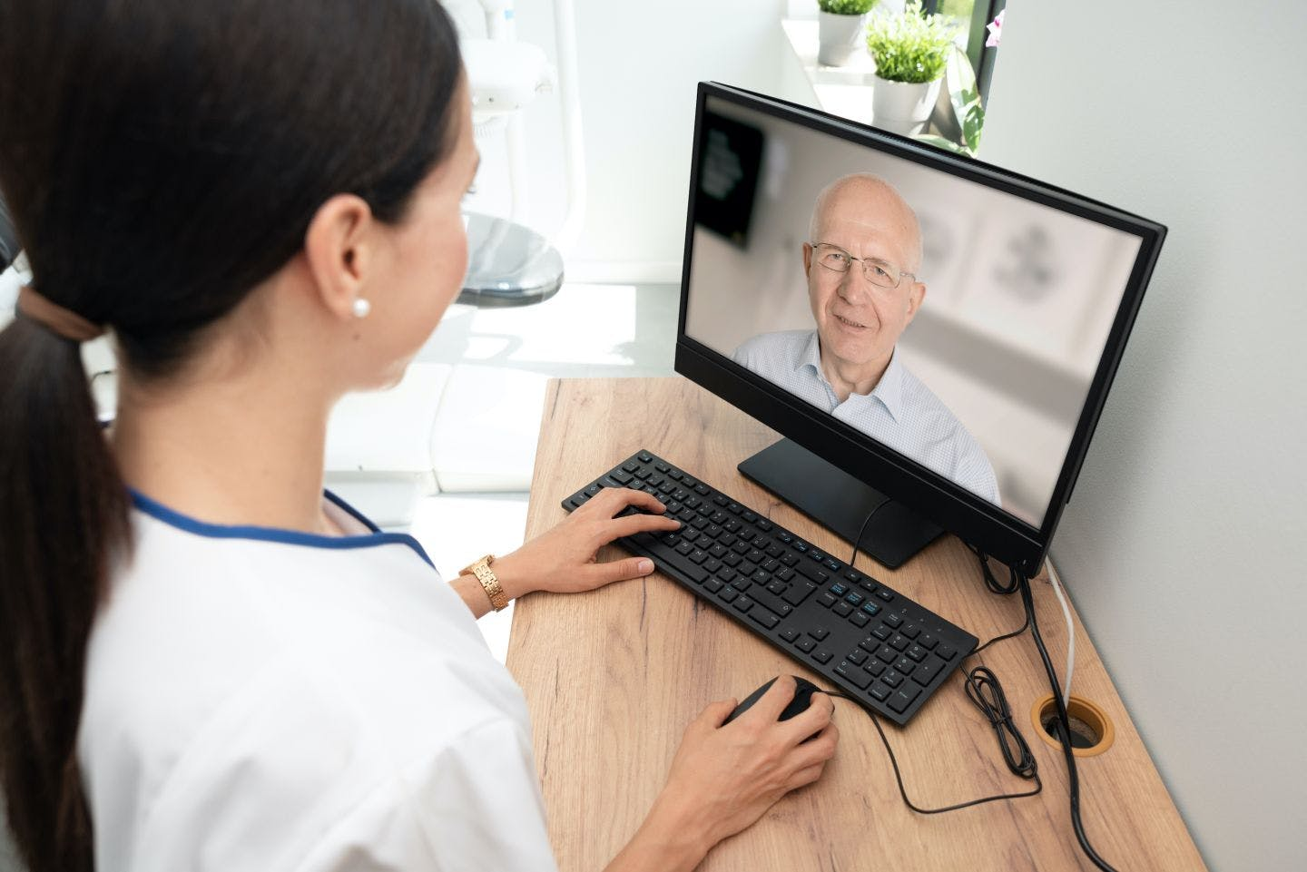 Telehealth session over laptop
